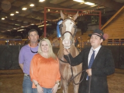 Kryton Parole winning the 2 yr old class with Tyler Baucom, greeted by Angela and Mike Klutz.jpg